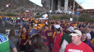 Crowds of people leaving the football game