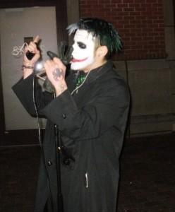 """""""Joker,"""" sings on the mic."""