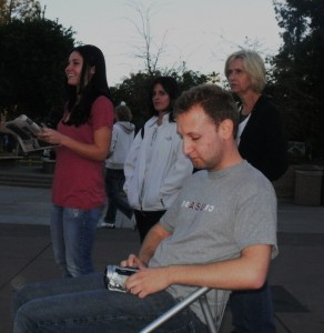 A few women(and Eddie!) laugh along with Jonathan as he shares a humerous part of his testimony
