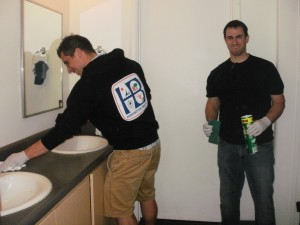 "Phil and Walter put the final cleaning touches on a bathroom(next time I will have to tak ""before,"" pictures)."