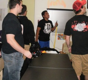 The guys help a student clean up his dorm from a party the night before. Haha